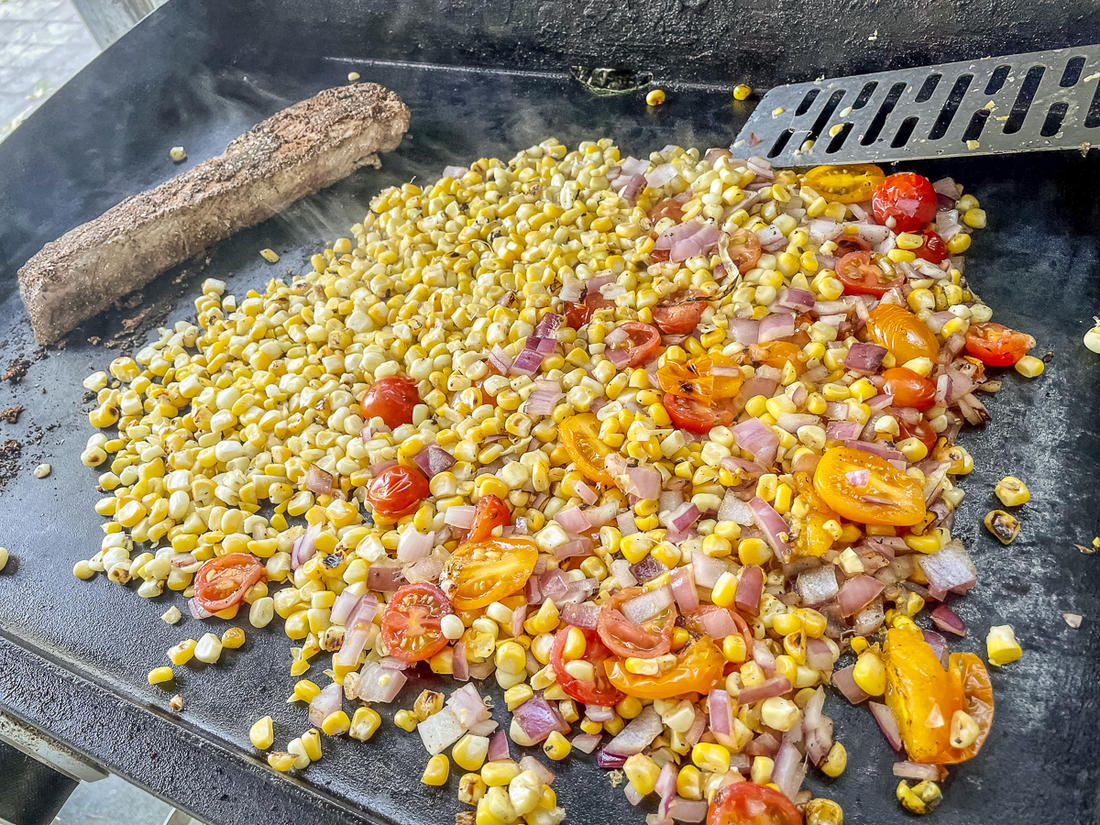 Sear the backstrap and corn mixture in a skillet or on an outdoor griddle.