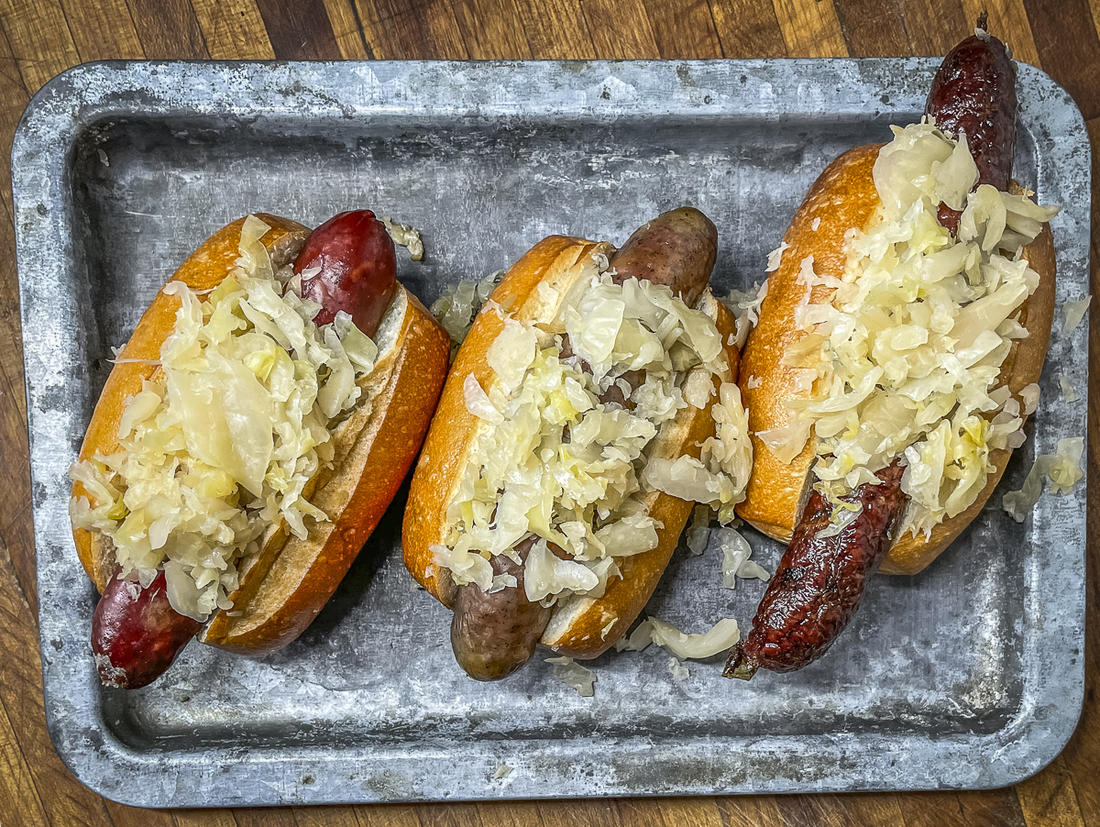 Serve the sausages on a bun and piled high with smoked sauerkraut.