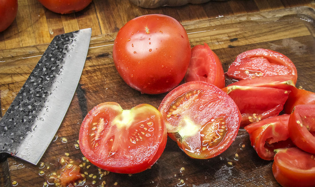 Cut your ripe tomatoes into wedges and remove most of the seeds.
