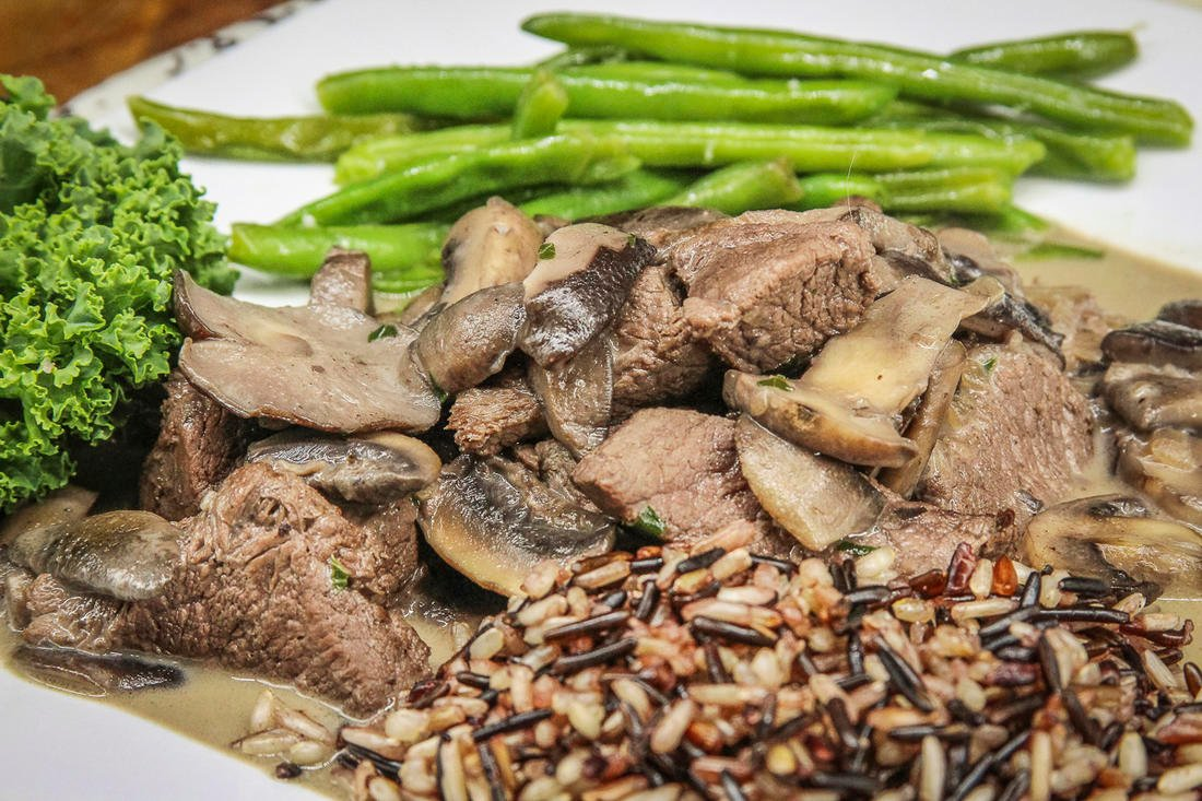 Serve the venison and mushrooms with rice or pasta and a favorite vegetable.