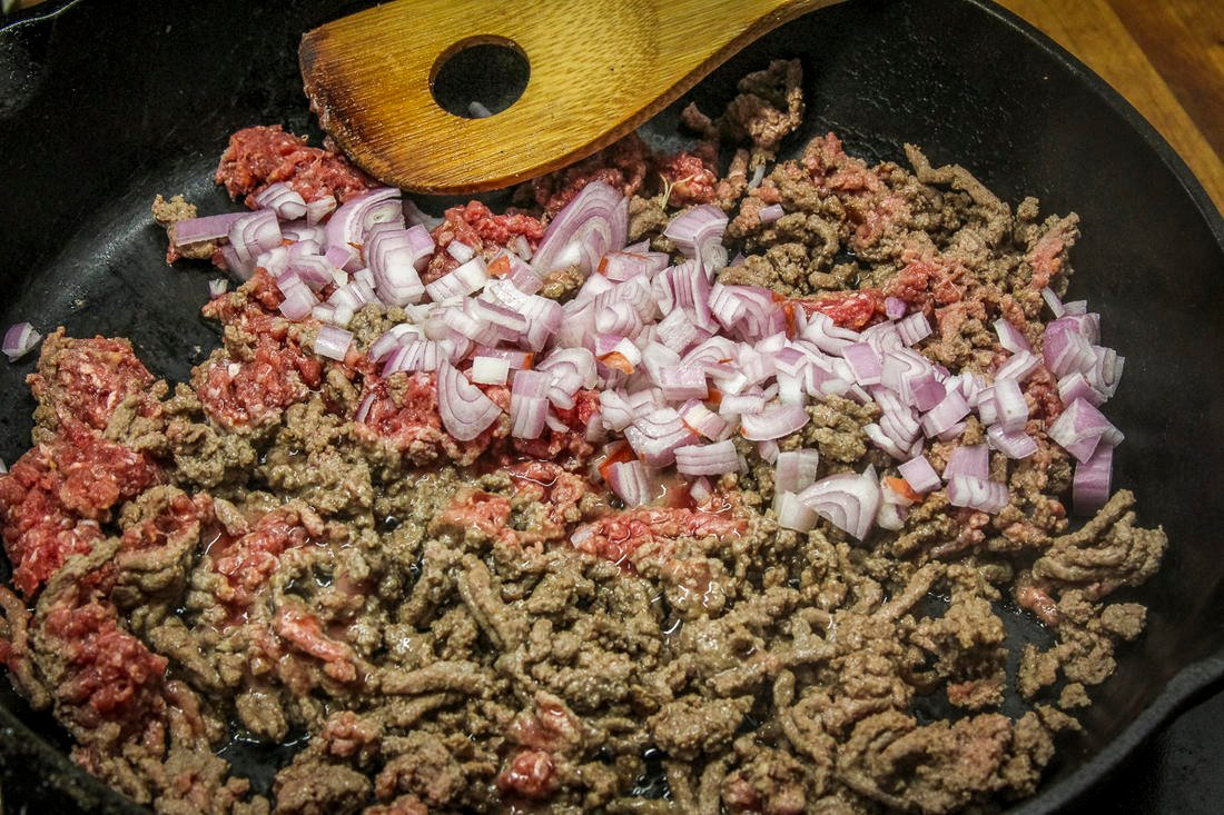 Brown the ground venison with the shallot and garlic, then add the reserved tomato pulp.