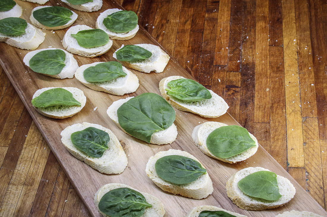 A baby spinach leaf is the perfect size to act as a moisture barrier between the venison and toast.