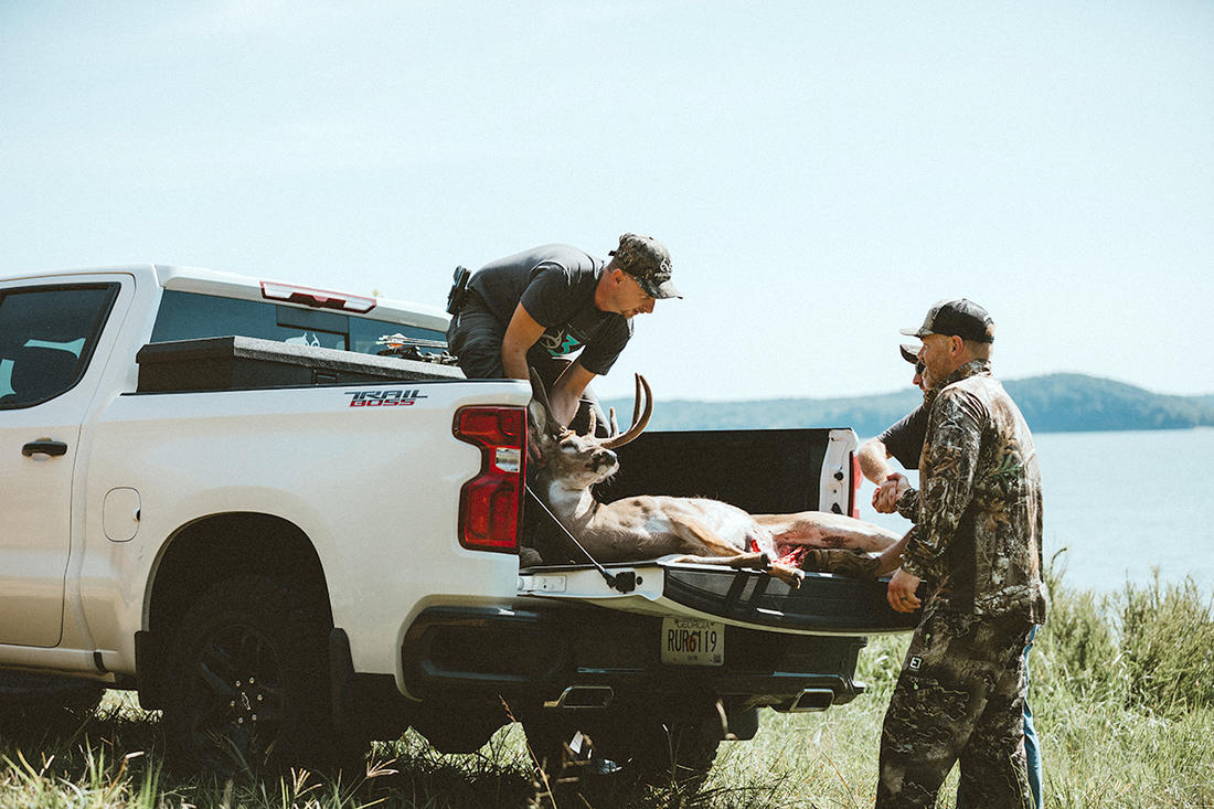 Killing a deer during warm weather means getting it loaded and to a walk-in cooler or quartered up and on ice quickly. Having a few buddies around speeds the process. Image by Kerry Wix