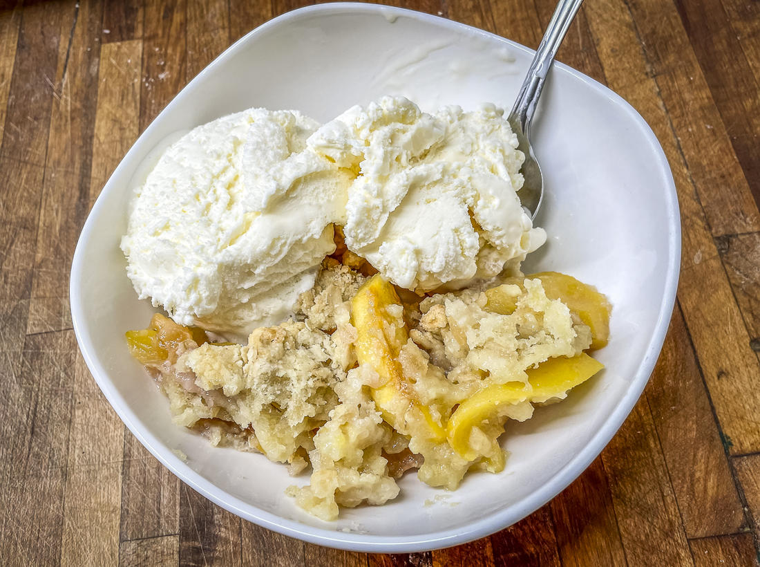Serve the grilled peach cobbler with a bowl of good vanilla ice cream.