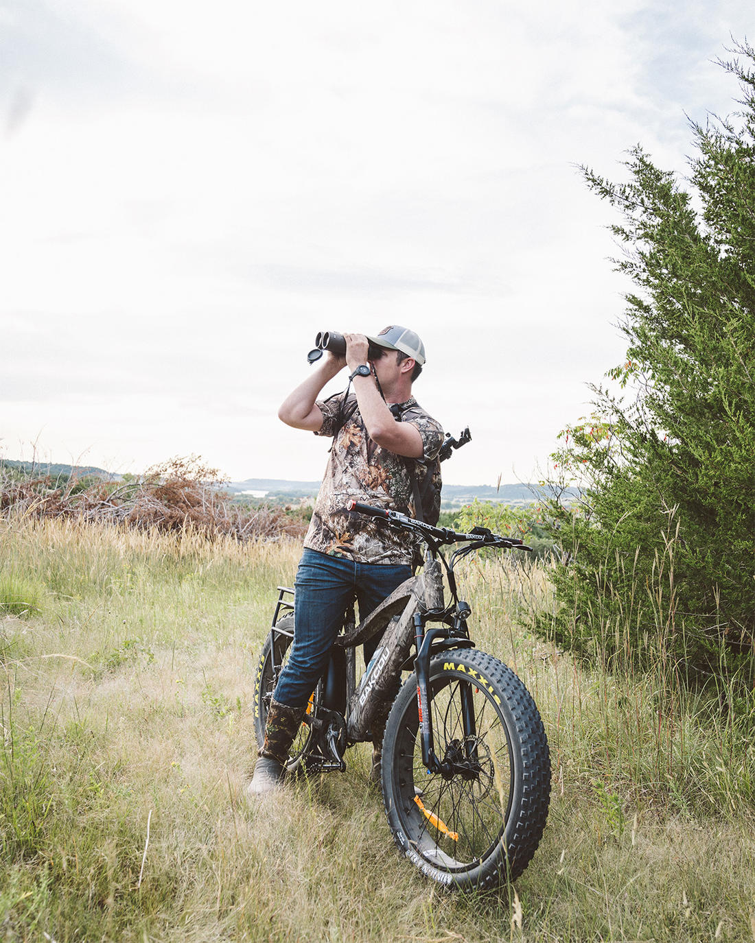 Realtree's Tyler Jordan field-tests one of Bakcou's nifty e-bikes. A headlight and mud fenders trick them out, and you can bungee cord a wild turkey to the rear pannier rack. Image by Realtree 365