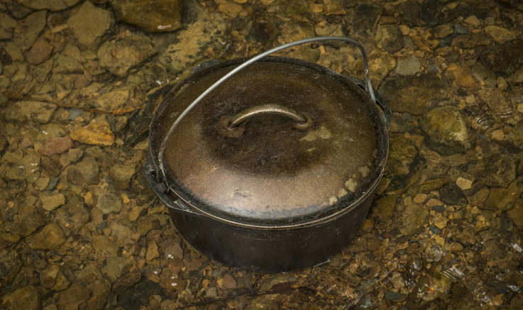 A 5-quart Dutch oven is perfect for cooking beans or stews over the fire. Photo B. Konway